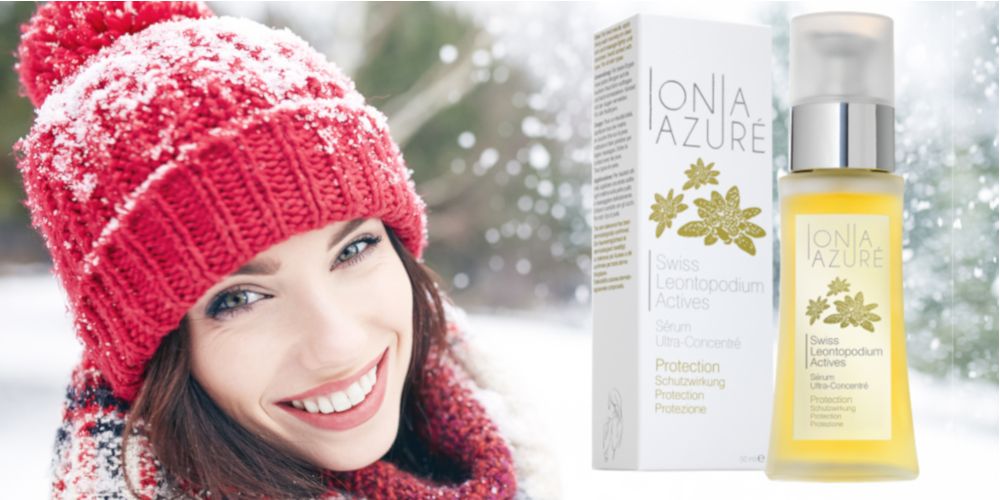 Smily girl outdoors in winter with Edelweiss serum