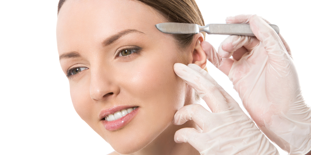 Woman undergoing classical dermaplaning with scalpel